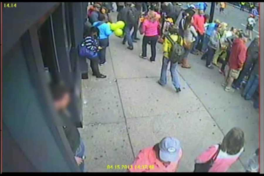 By 2:37:48 on April 15, the suspects have walked out of the video frame, while the woman with the balloons stayed in the area.