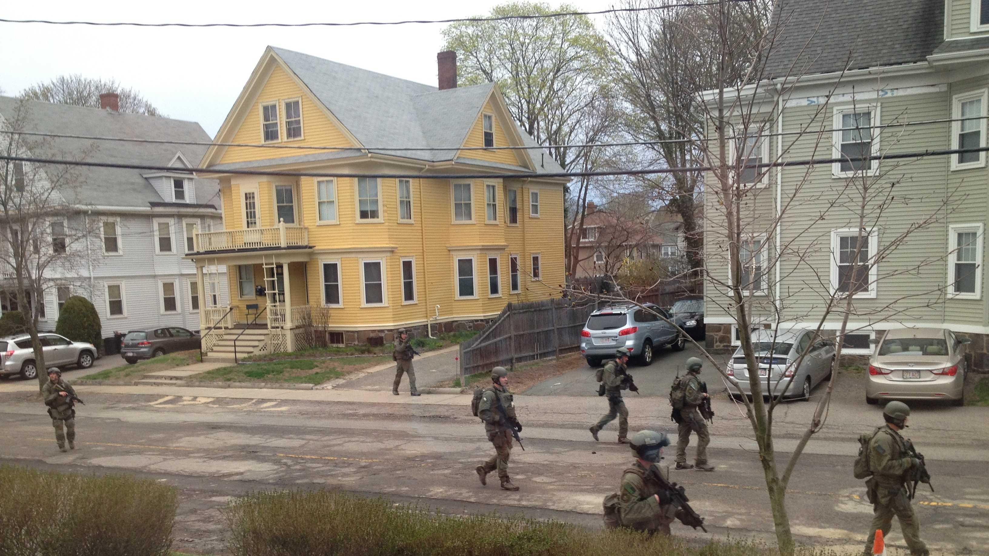 Police conduct door-to-door searches in Watertown