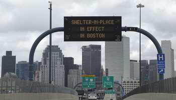 """A sign calling for citizens of Boston to """"Shelter in Place"""" is shown on I-93 in Boston."""