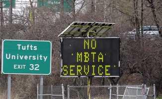 A sign along I-93 in Medford announces no MBTA service Friday, April 19, 2013.