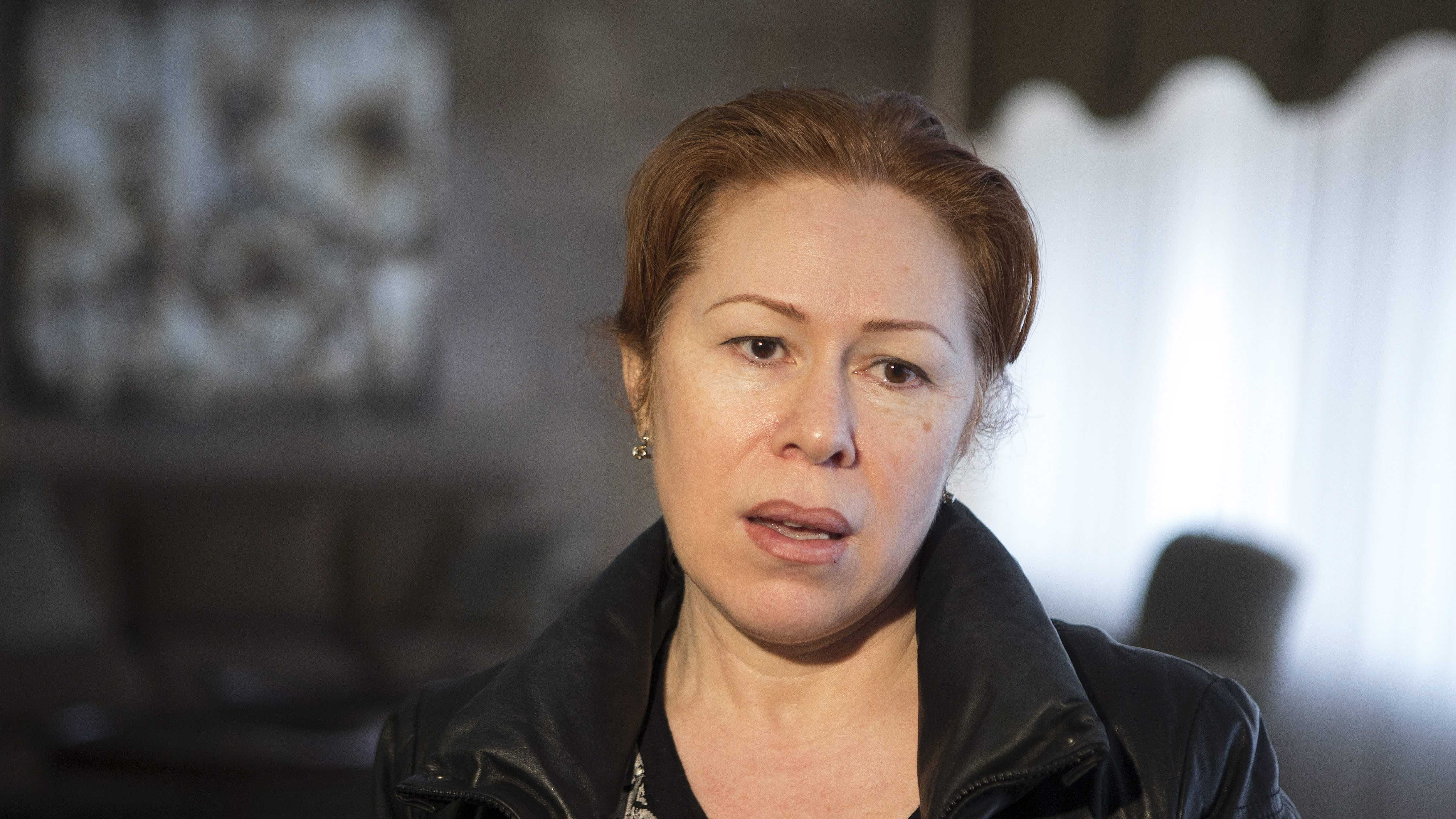 Maret Tsarnaeva, an aunt of the two suspects in the Boston Marathon bombing, speaks to journalists in the lobby of her apartment building in Toronto
