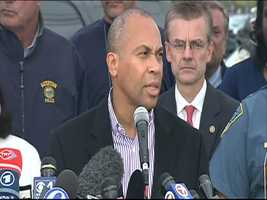 "Around 6:30 p.m., Massachusetts Gov. Patrick Deval announces that mass transit is resuming and the ""stay indoors"" order is being lifted even though one suspect remains on the lam."