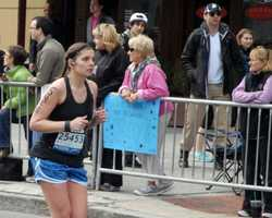 This Monday, April 15, 2013 photo provided by Bob Leonard shows second from right, Tamerlan Tsarnaev, who was dubbed Suspect No. 1 and walking behind him, Dzhokhar A. Tsarnaev, who was dubbed Suspect No. 2 in the Boston Marathon bombings by law enforcement. This image was taken approximately 10-20 minutes before the blast.