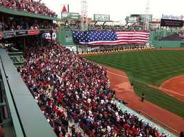 The American Flag is flag unfurled over the Green Monster.
