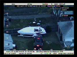 This photo appears to show a metallic arm lifting the tarp off the boat.