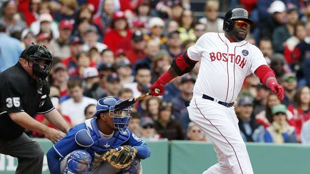 Boston Red Sox's David Ortiz, right, hits a single in front of Kansas City Royals catcher Salvador Perez in the fourth inning of a baseball game in Boston, Saturday, April 20, 2013.