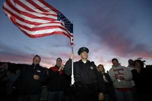Hundreds of residents, visitors and police officers came to Wilmington Saturday night for a vigil to honor MIT Police Officer Sean Collier.