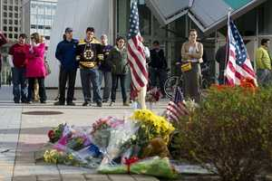 People gather at a small memorial for slain MIT police officer Sean Collier between the STATA Center and Koch Institute on MIT's campus in Cambridge, Mass., on April 20, 2013.
