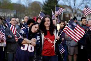 People gather on a field during a vigil for MIT police officer Sean Collier in Wilmington.