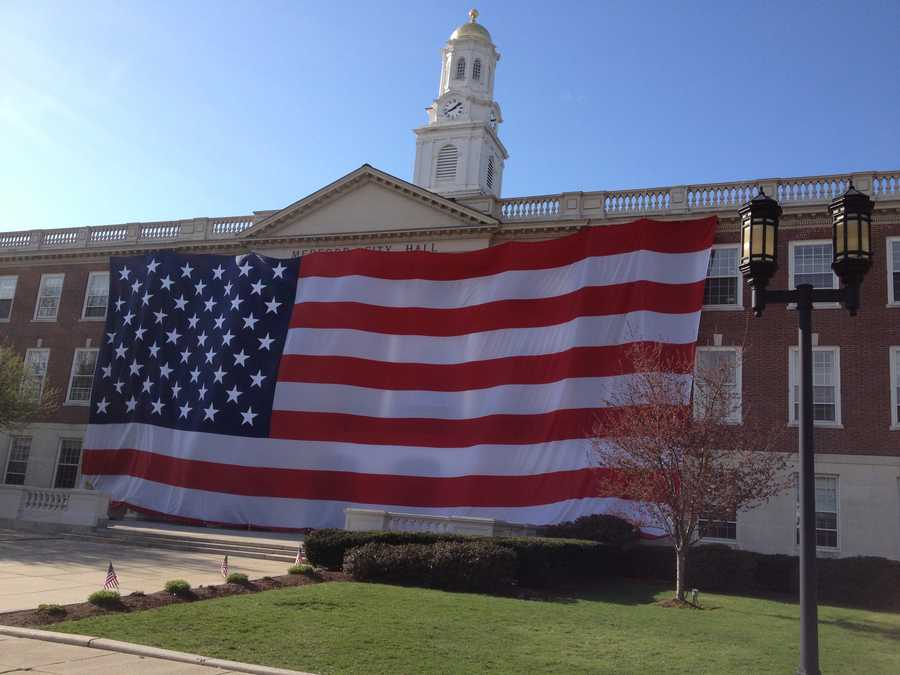 The city of Medford draped a 45 foot by 90 foot American flag across the entire front of Medford city hall in honor of Krystle Campbell and all the victims of the Boston marathon terrorists attacks.