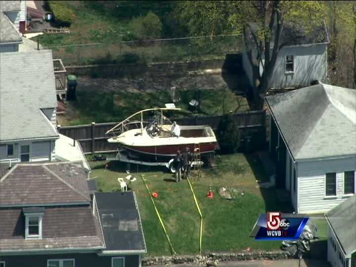 Investigators were sifting through evidence in and around the boat in a Watertown backyard where second bombing suspect Dzhokhar Tsarnaev was discovered.