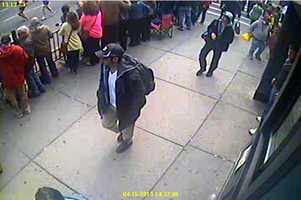 At approximately 2:42 pm (approximately seven minutes before the first blast), bomber one can be seen detaching himself from the crowd and walking east on Boylston Street toward the finish line.  Approximately 15 seconds later, he can be seen passing directly in front of the Forum Restaurant and continuing in the direction of where the first explosion occurred. His backpack is still on his back.