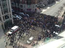 A moment of silence is observed on Boylston Street.