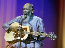 """Richie Havens sang and strummed for a sea of people at Woodstock Havens, a folk singer and guitarist, performed at the 1969 Woodstock Festival. Havens said in a 2009 interview with The Associated Press about Woodstock: """"Everything in my life, and so many others', is attached to that train."""" (January 21, 1941 – April 22, 2013)"""