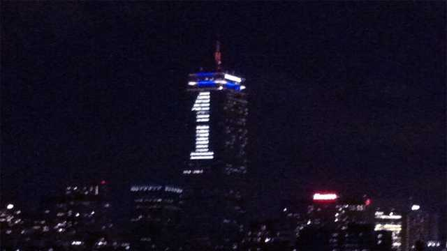 The Prudential Tower is lighted to highlight the  One Fund to benefit bombing victims.