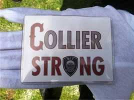 """Many were wearing buttons that read """"Collier Strong."""""""