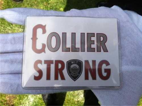 "Many were wearing buttons that read ""Collier Strong."""