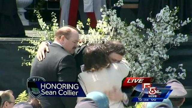 Collier's family embraces.