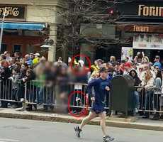 This photo taken before the bombings shows suspect Dzhokhan Tsarnaev in the background with what may be the bomb in a backpack in the lower part of the frame near the railing.