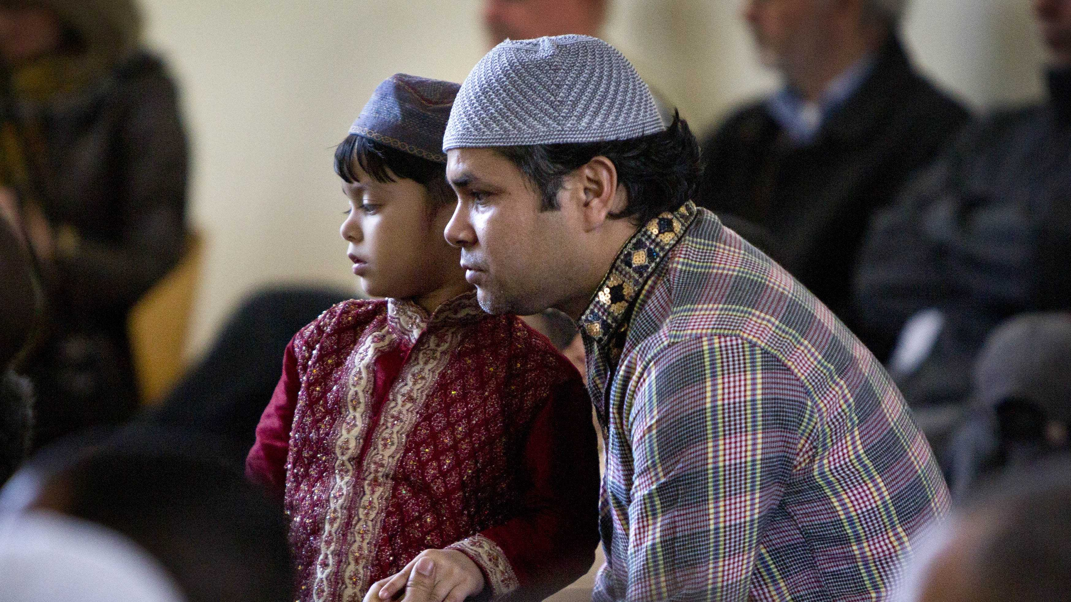 A father and son attend a prayer service at the Islamic Society of Boston mosque, Friday, April 26, 2013, in Cambridge, Mass.