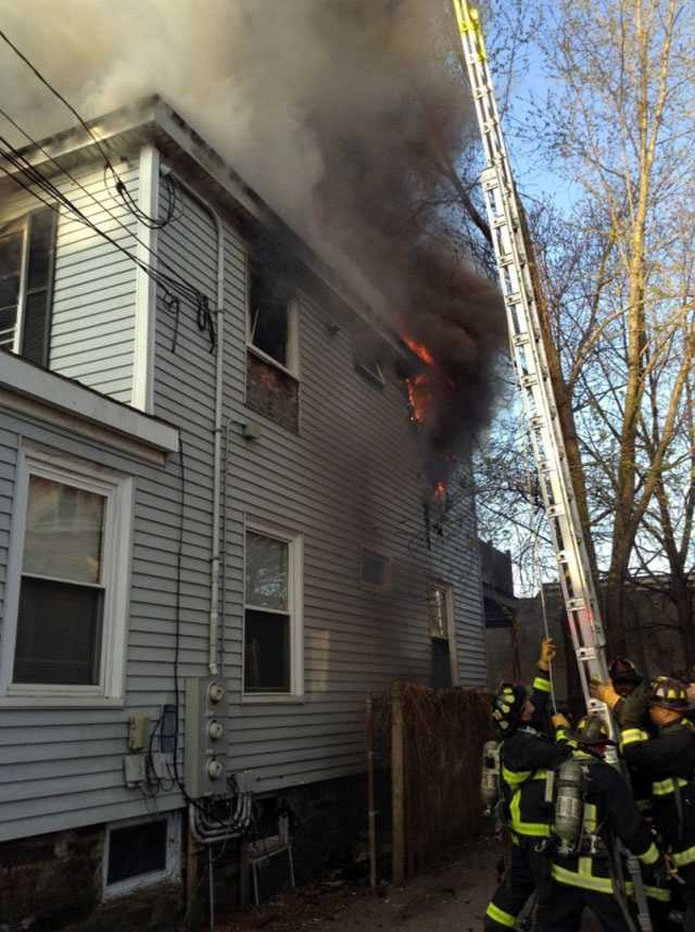 Three residents were rescued by Boston firefighters using ladders.