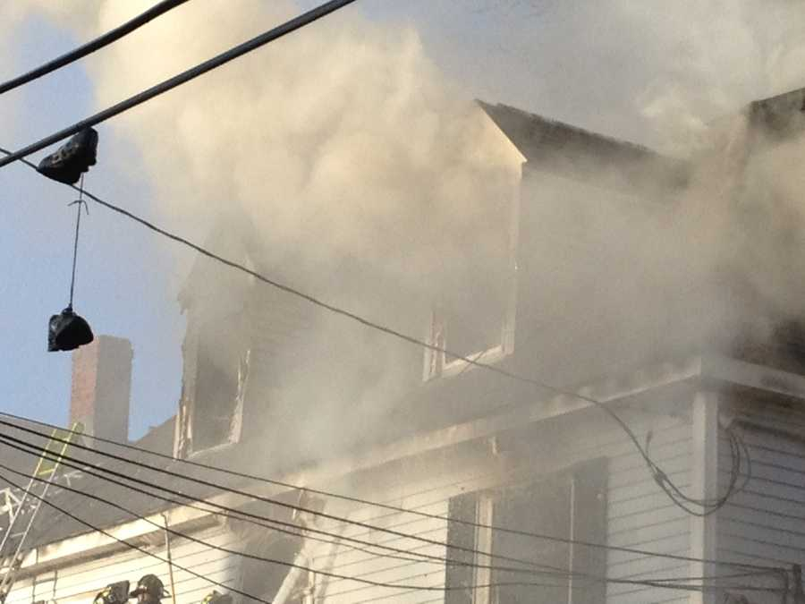 One occupant of the building jumped from an upper story, according to firefighters.