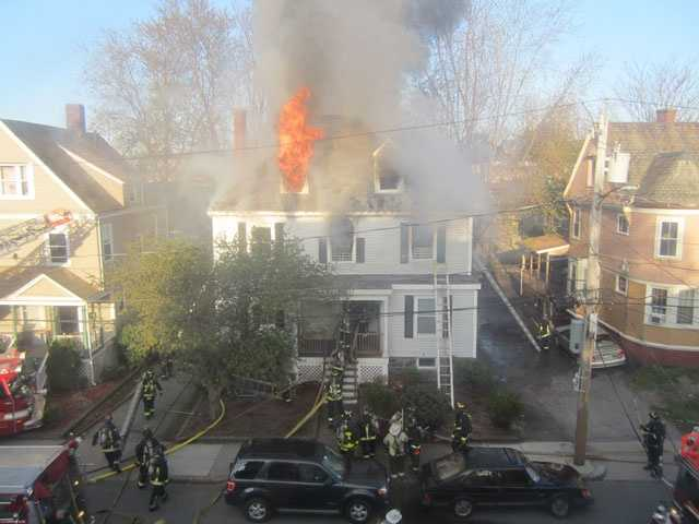 Fire officials said the woman who died had been trapped in the attic. She was identified by BU Today as Binland Lee, of Brooklyn, New York.