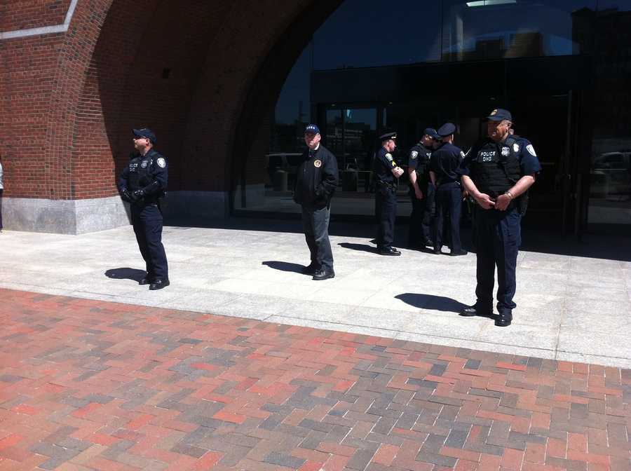Officers stand guard outside the federal court house in Boston.
