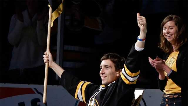 Boston Marathon bombing victim Jeff Bauman reacts as he is honored as the official flag-bearer before Game 2 of a first-round NHL hockey playoff series between the Boston Bruins and the Toronto Maple Leafs in Boston, May 4, 2013.