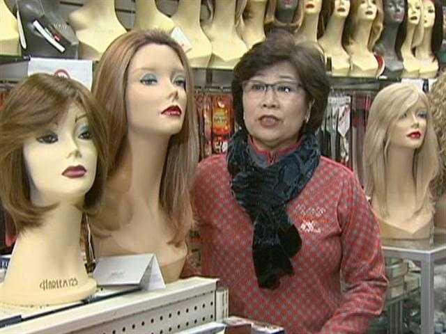 Owner Mi Kim stocks more than a thousand wigs.