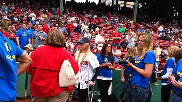 Heather Abbott, of Newport, R.I., makes a stop at Fenway Park after being discharged from Spaulding Rehabilitation Hospital on Saturday, May 11, 2013.