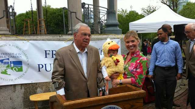 Boston Mayor Tom Menino greets families at the end of the parade route.