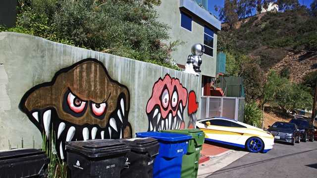 This Sunday, May 12,2013 photo shows a mural painted on the outside of Grammy-winning musician Chris Brown's Hollywood Hills home. Neighbors are unhappy with what some are calling frightening art he's chosen to have painted along the curb.
