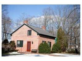 A brick schoolhouse has been restored as a guest home.