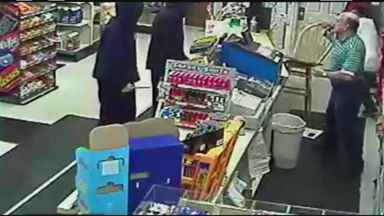 Store clerk hurls chair at would-be robbers