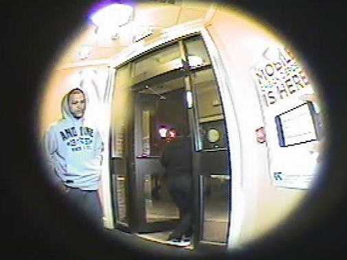 Police in Lowell are searching for a man officials say robbed five customers at an ATM.