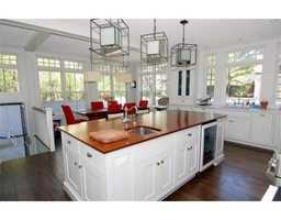Chef's kitchen with marble and hardwood counter tops, Sub Z fridge, professional range and wine storage.