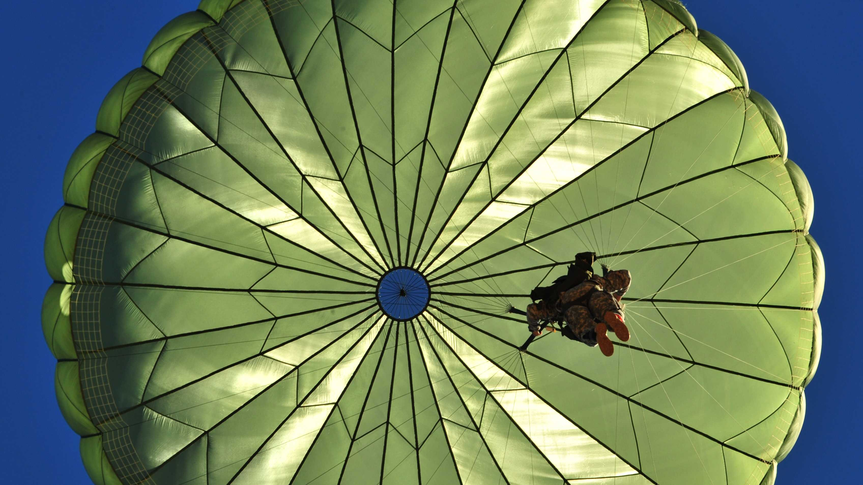 FILE - A paratrooper participates in a personnel drop, an exercise that uses several Air Force aircraft to strategically airdrop troops and cargo.