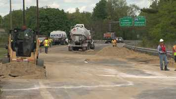 Hazmat crews spent hours at the scene Saturday working to clean up fuel that spilled onto the highway.