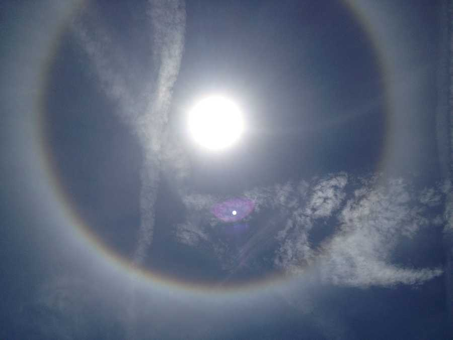 The halo is caused by tiny ice crystals contained in high cirrostratus clouds.