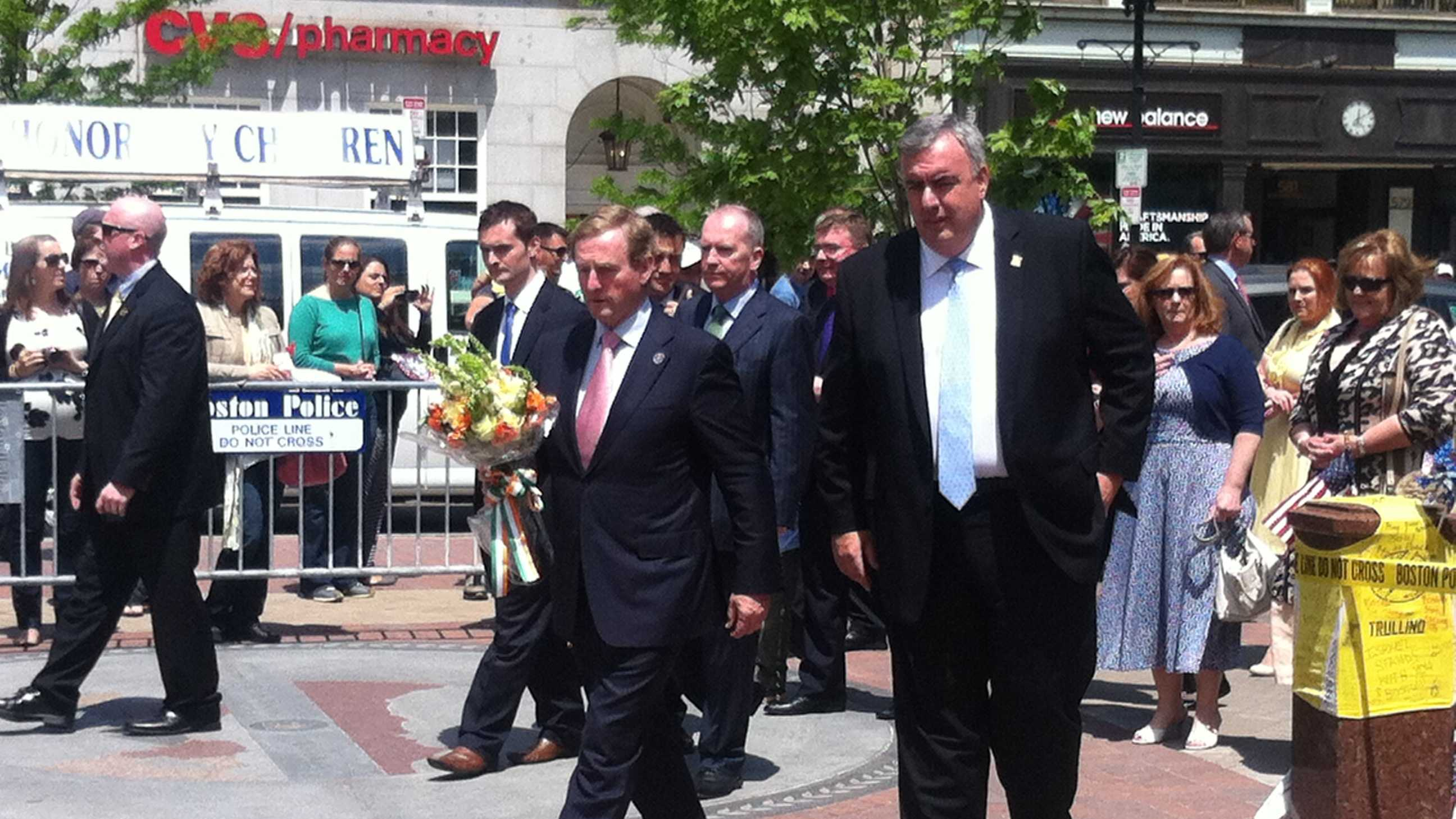 The Prime Minister of Ireland, Enda Kenny, visited the Boston Marathon memorial site in Copley Square with Boston Police Commissioner Ed Davis Sunday.