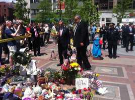 During a noontime ceremony, Kenny - flanked by Boston Police Commissioner Ed Davis - laid several bouquets of flowers at the Copley Square memorial.