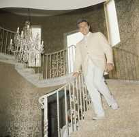 """The flashy showman came to fame in the 1950s with television's """"The Liberace Show,"""" gaining him a fan base who delighted in his costumes and humor."""