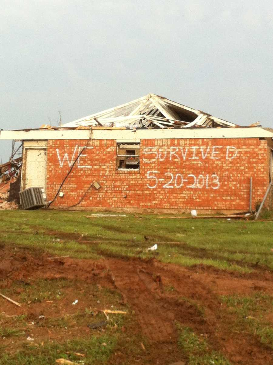 """""""We survived"""" written on the side of one home in Moore, OK following the May 20th storm."""