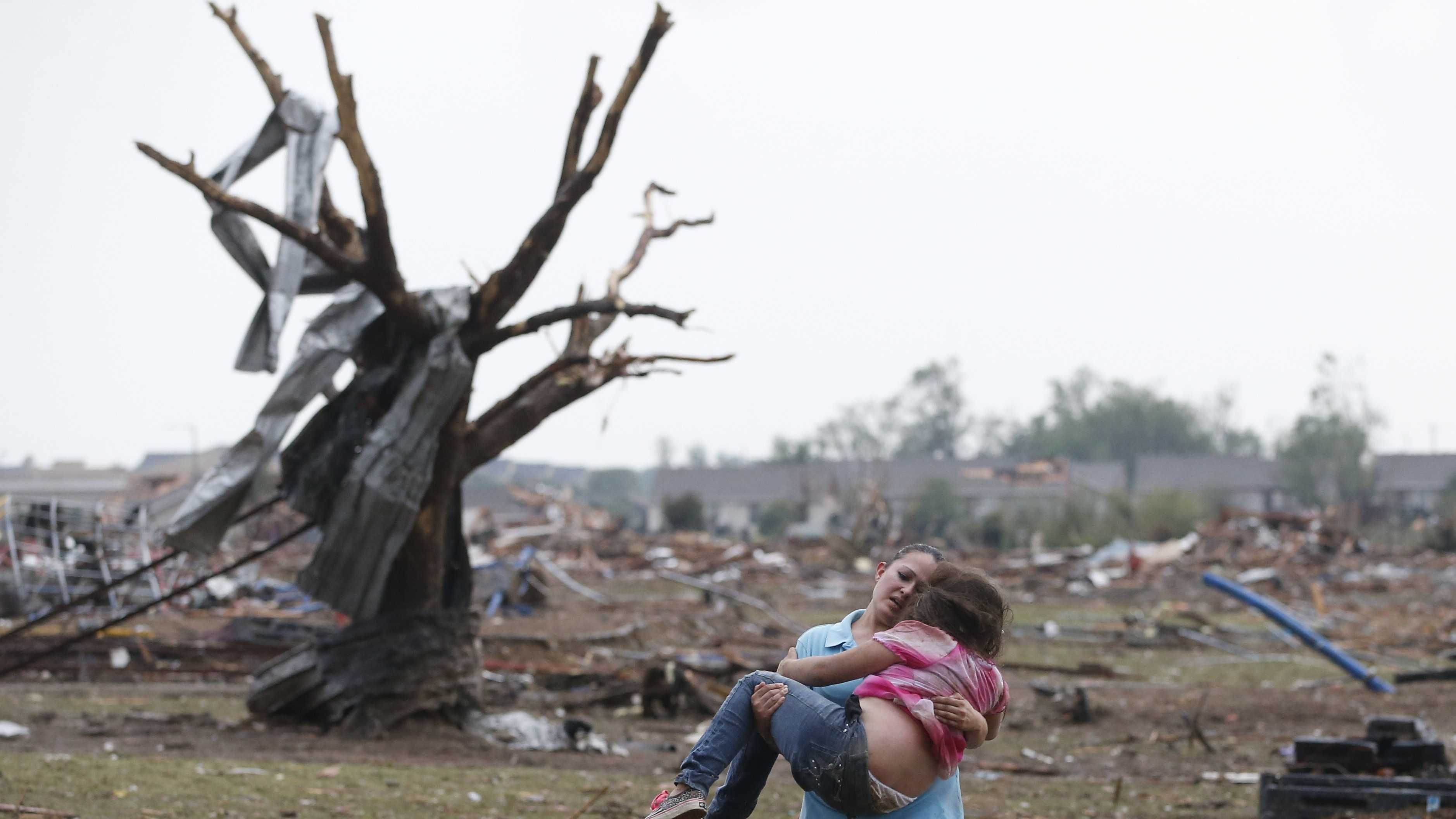OK Tornado Woman Carries Child 052113