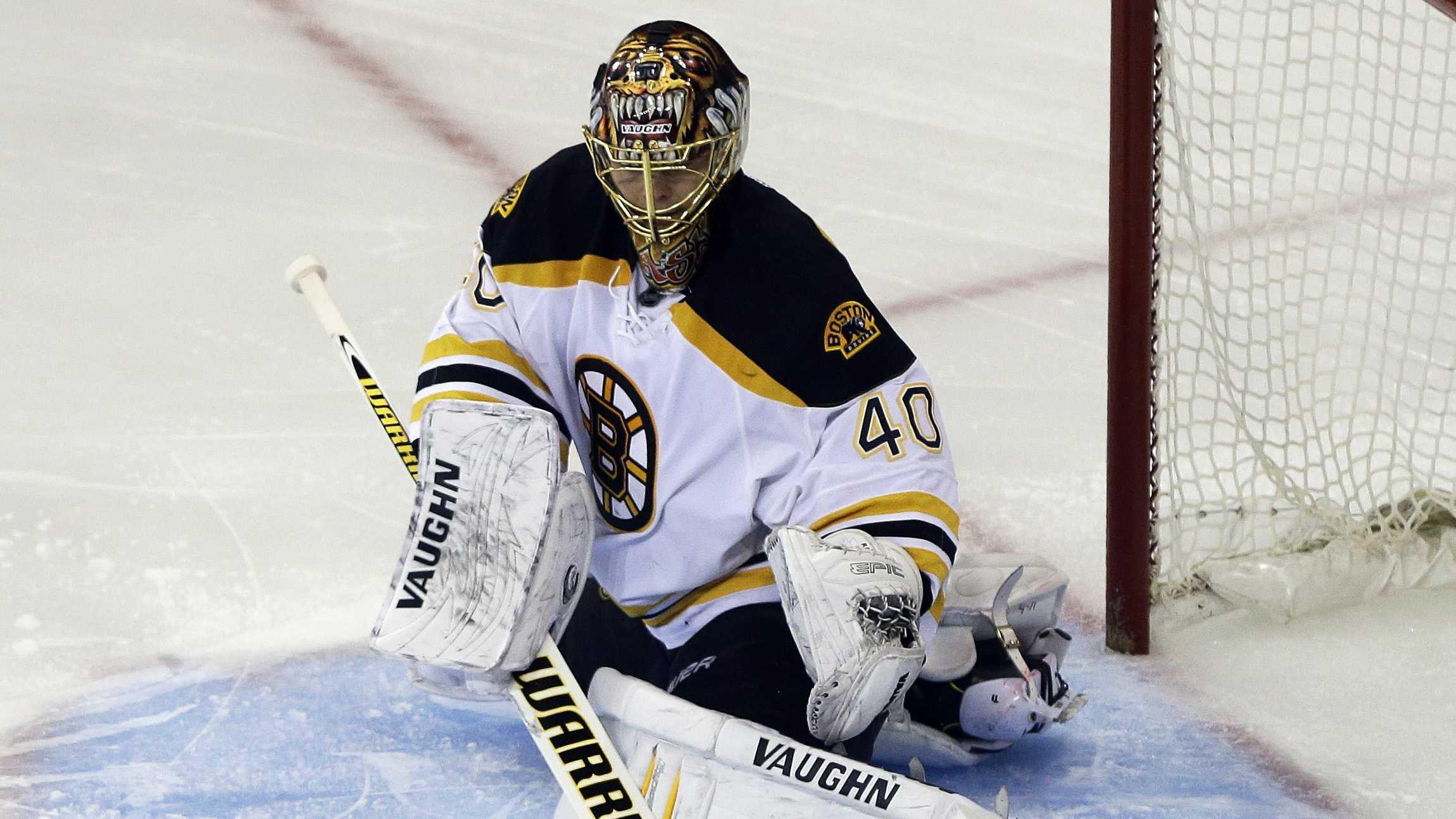 Boston Bruins goalie Tuukka Rask stops a shot on the goal against the New York Rangers