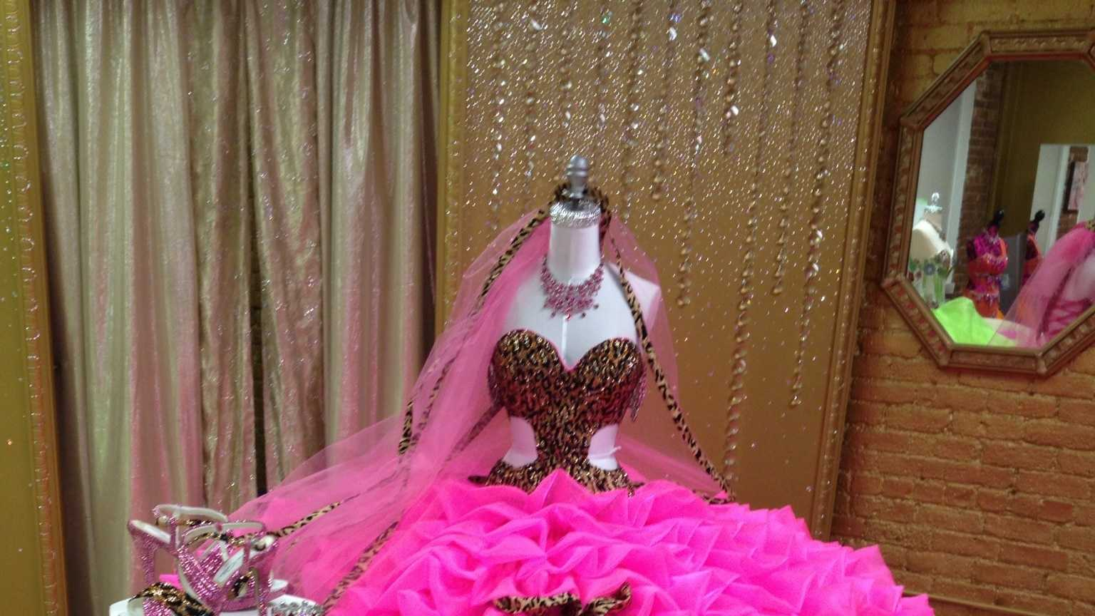 "When asked to custom design a wedding dress for ""Hellie"" Mellie Stanley, Sondra Celli, ""America's No.1 Gypsy Designer"" combined a wild leopard print with a ""screaming"" hot pink satin organza."