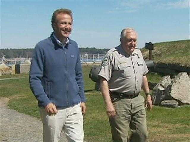 """Anthony walks with Charlie """"Doc"""" Docthammer of the Maine Department of Agriculture, Conservation and Forestry."""