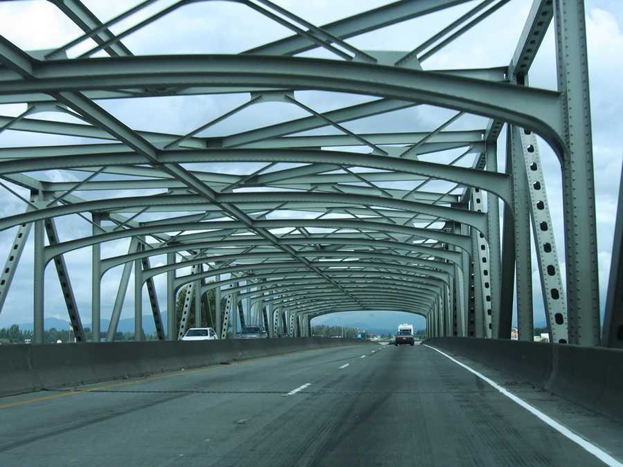 This is a photo from August 2006 of the 1955 steel through truss bridge, which carries Interstate 5 across the Skagit River. This is a northbound view of the freeway.
