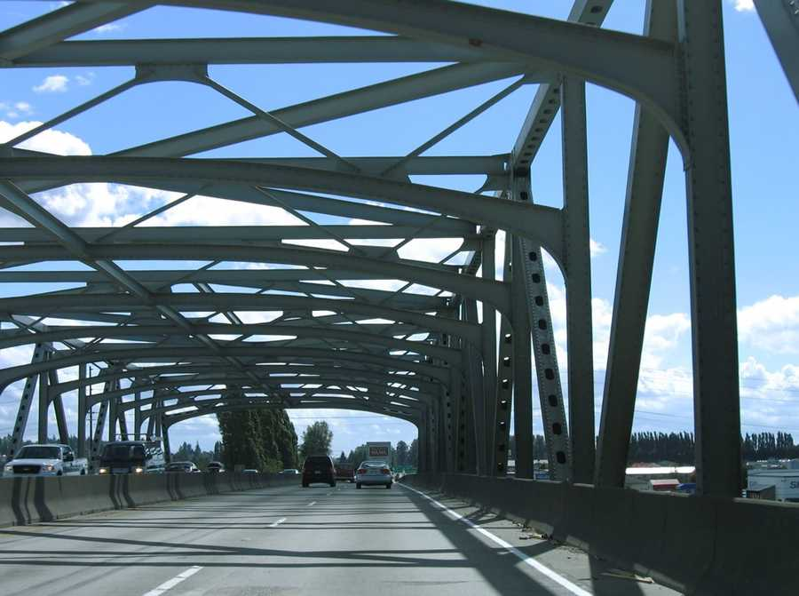 This is a photo from August 2006 of the 1955 steel through truss bridge, which carries Interstate 5 across the Skagit River. This is a southbound view of the freeway.